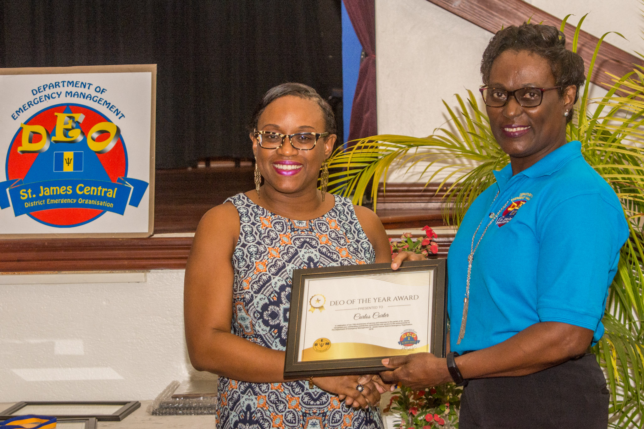 Alicia Sobers receives DEO of the Year Award on behalf of Carlos Carter