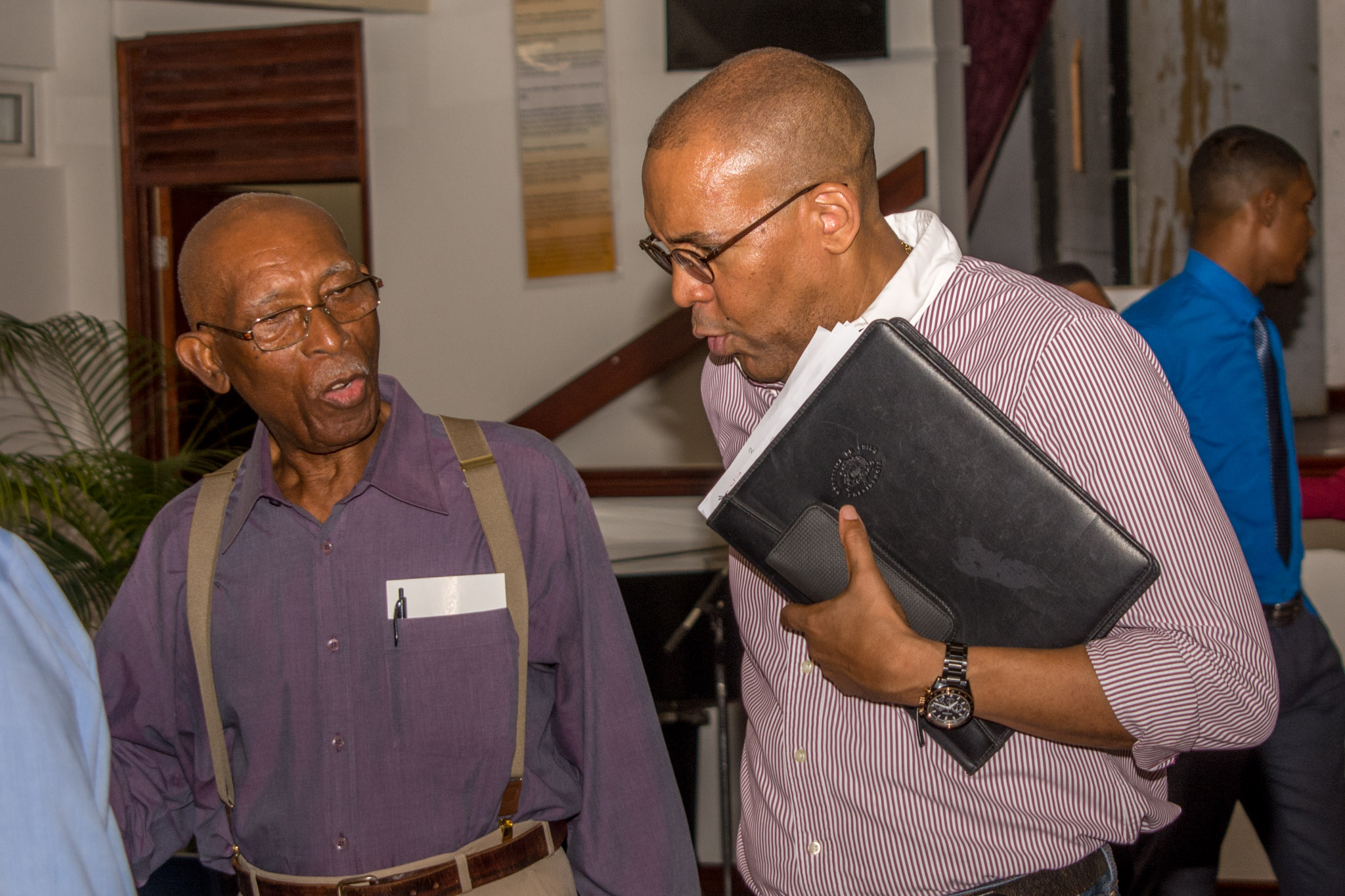 Hon. Kerrie Symmonds speaking with founding member Mervyn Cumberbatch